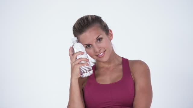 ms young woman holding water bottle / orem, utah, usa - orem video stock e b–roll