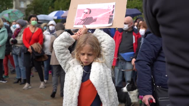 "young woman holds a sign where it says ""i'm teacher"" during the rally in memory of french teacher samuel paty on october 18, 2020 in lille, france.... - decapitated stock videos & royalty-free footage"