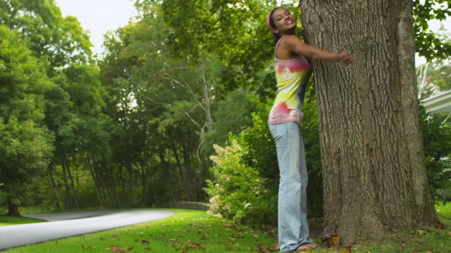 ws young woman hugging and kissing tree / manchester, vermont, usa - tree hugging stock videos & royalty-free footage