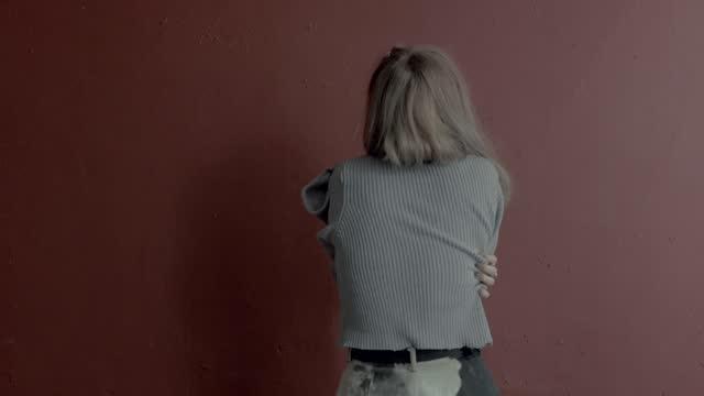 young woman hugging self - hugging self stock videos & royalty-free footage