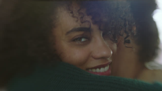 vidéos et rushes de cu slo mo. young woman hugs boyfriend and smiles at camera. - cheveux bruns