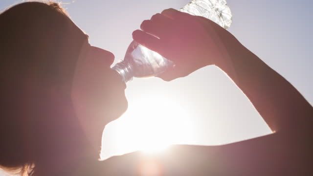 young woman hydrating after high intensity workout - sweat stock videos & royalty-free footage