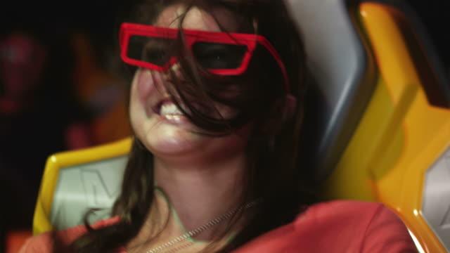 cu young woman in 3-d movie theater, orem, utah, usa - orem bildbanksvideor och videomaterial från bakom kulisserna