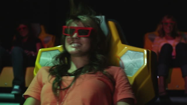 MS Young woman in 3-D movie theater, Provo, Utah, USA