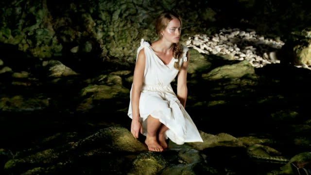 young woman in a cave - white dress stock videos & royalty-free footage
