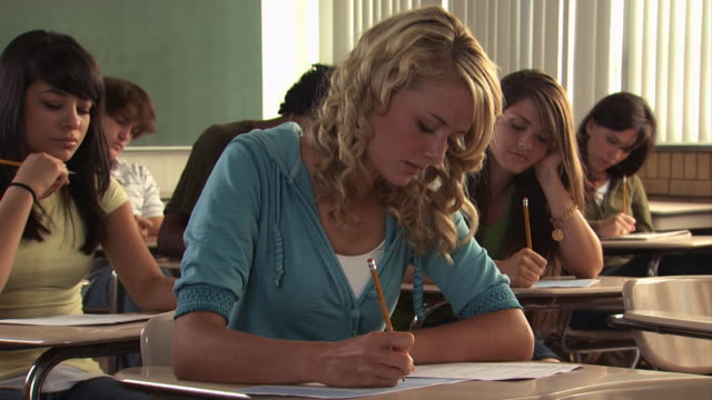 young woman in a classroom - see other clips from this shoot 1148 stock videos and b-roll footage