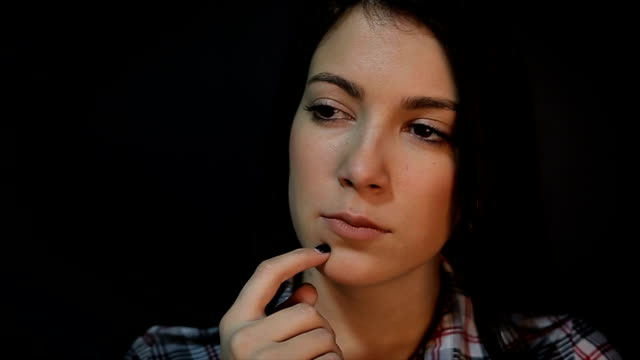 young woman in a dilemma,close up - suspicion stock videos & royalty-free footage