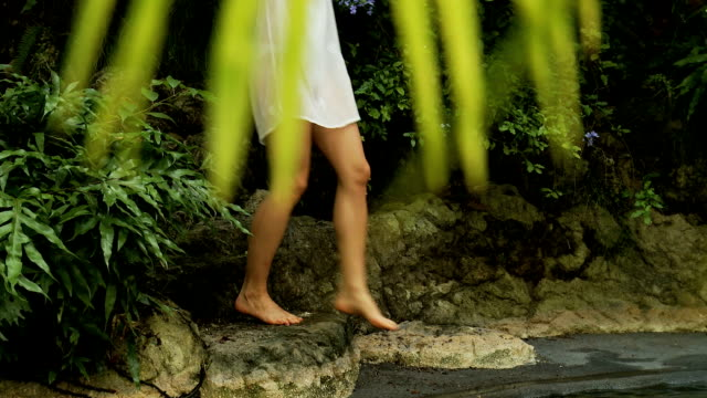 young woman in a tropical forest - white shirt stock videos & royalty-free footage