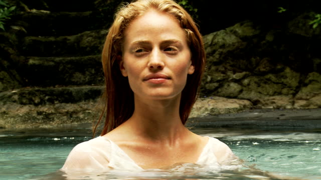 young woman in a tropical pool - white shirt stock videos & royalty-free footage