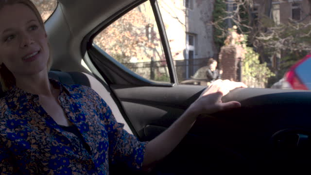 young woman in back seat at car, beautiful sunny day nyc - passenger seat stock videos & royalty-free footage