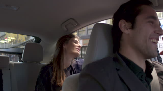 young woman in back seat of car, beautiful sunny day nyc - looking through window stock videos & royalty-free footage