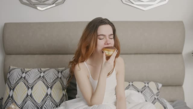 young woman in bedroom - donut stock videos and b-roll footage
