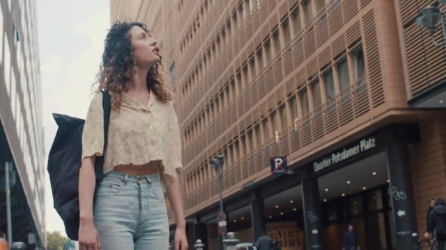 young woman in central berlin - 様式点の映像素材/bロール