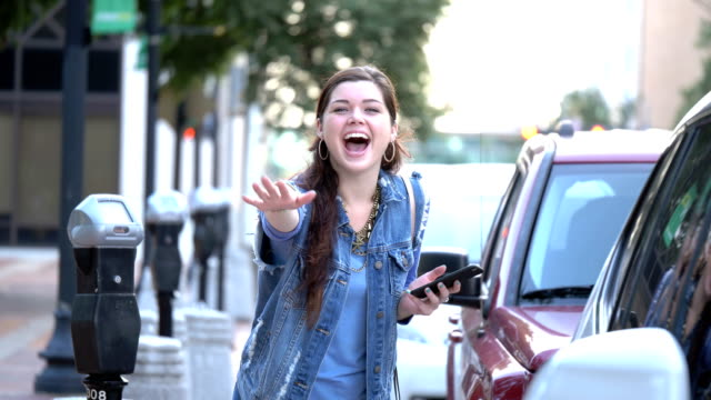 young woman in city, waving to the camera - denim jacket stock videos & royalty-free footage