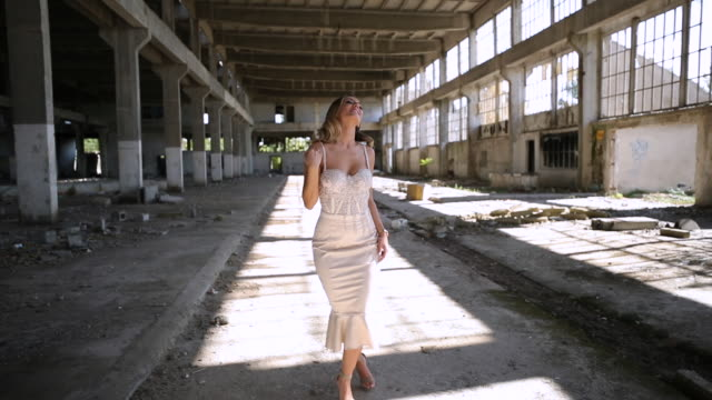 young woman in elegant dress in abandoned warehouse - sandal stock videos & royalty-free footage