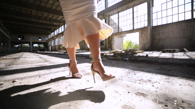 young woman in elegant dress in abandoned warehouse - high heels stock videos & royalty-free footage