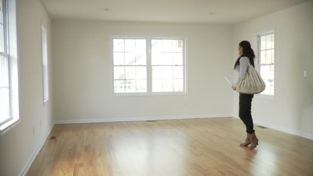WS, PAN, Young woman in empty room, Plainfield, New Jersey, USA