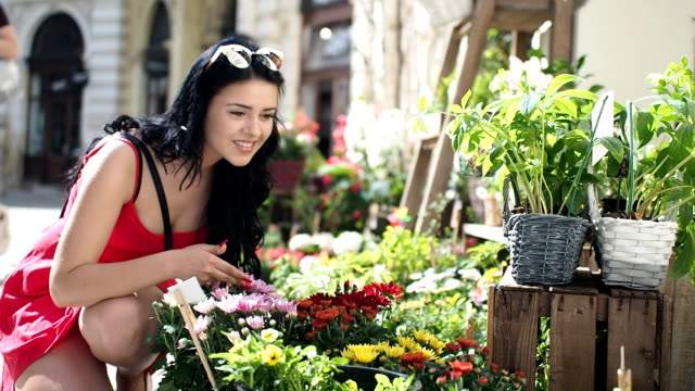 young woman in front of florist shop - slow motion - dress stock videos & royalty-free footage