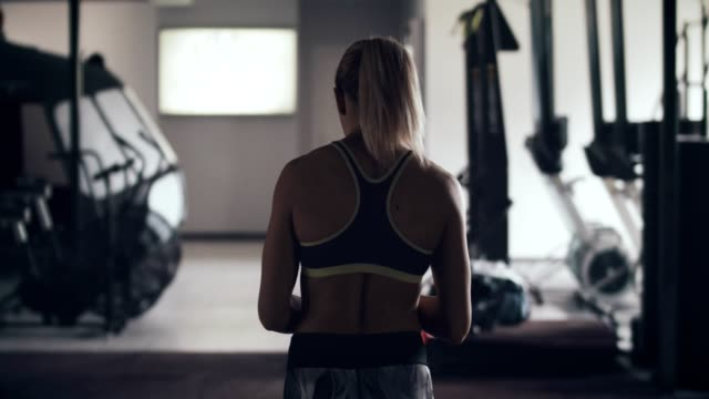young woman in gym - chin ups stock videos and b-roll footage