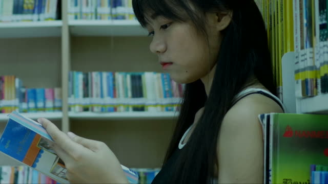 young woman in library ,serious face