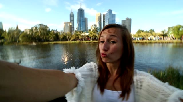 Young woman in Melbourne takes a selfie portrait