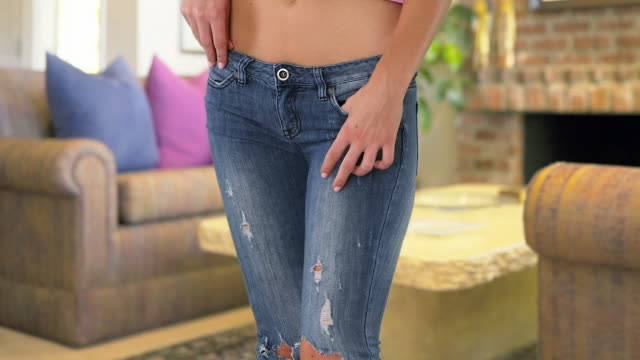 young woman in old torn jeans - pants stock videos and b-roll footage