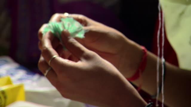 CU TU Young woman in Prerana women's sewing group making fabric flowers, Lalkuan, Uttarakhand, India