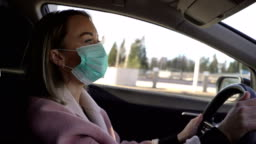 Young woman in protective sterile medical face mask in a car,