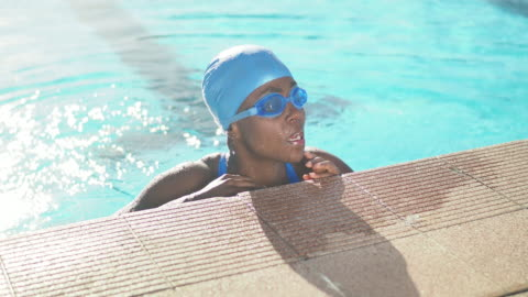 young woman in public swimming pool - swimming goggles stock videos & royalty-free footage