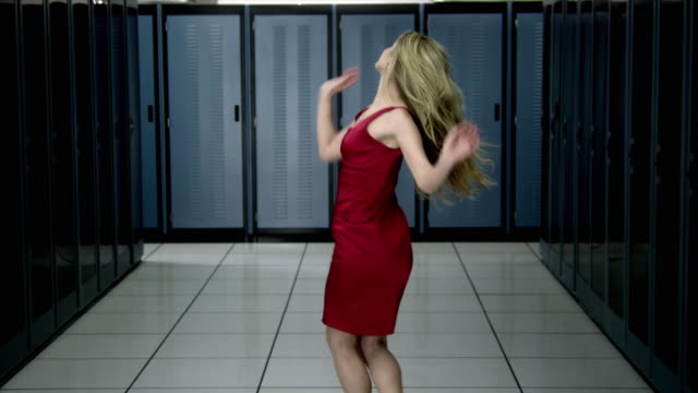 ms ds young woman in red dress dancing in server room - see other clips from this shoot 1480 stock videos and b-roll footage