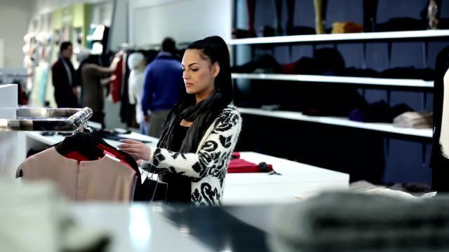 young woman in retail store - retail stock videos and b-roll footage