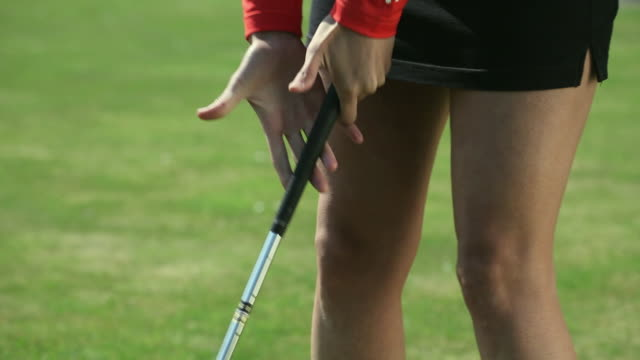 cu young woman in shorts hitting golf ball / canterbury, kent, uk - golf club stock videos and b-roll footage