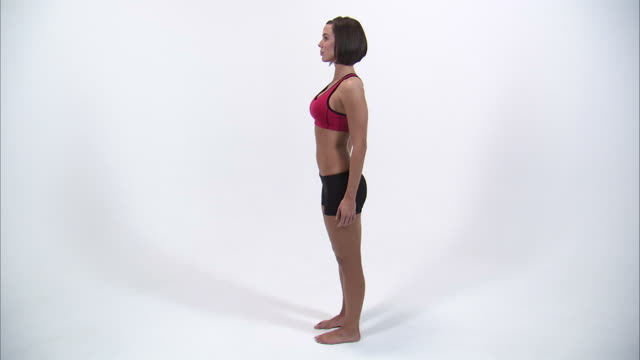 ws young woman in sports bra and shorts, side view / orem, utah, usa - sports bra stock videos & royalty-free footage