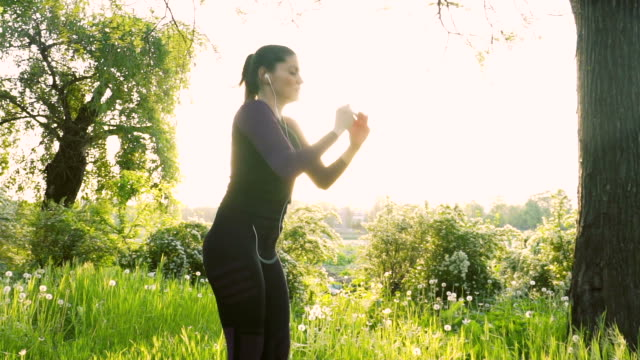 Young woman in sportswear exercising in the park.