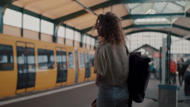 young woman in subway station in berlin - lässige kleidung stock-videos und b-roll-filmmaterial