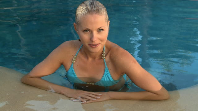 ms young woman in swimming pool / cape town, south africa  - wet hair stock videos and b-roll footage