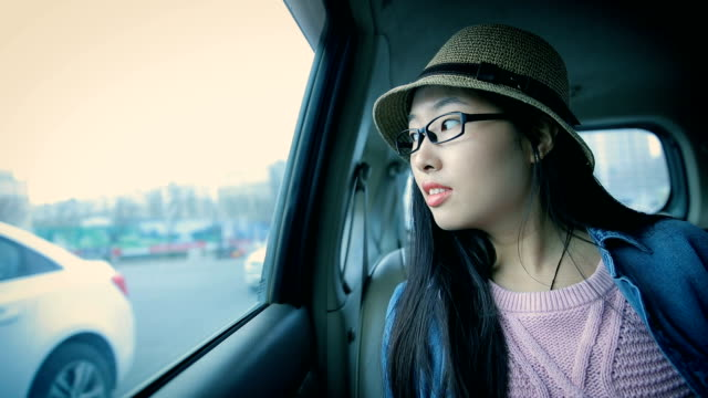 Young woman in the car,looking out of window