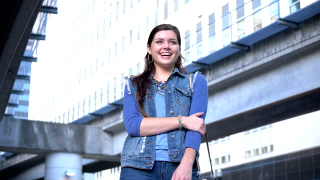 young woman in the city, smiling - denim jacket stock videos & royalty-free footage