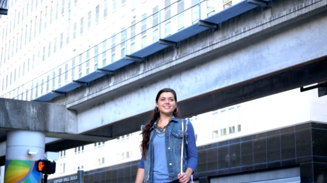 young woman in the city, walking - denim jacket stock videos & royalty-free footage