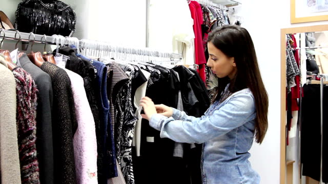 Young woman in the clothing store