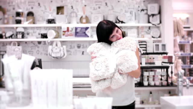 young woman in the cosmetic store - soft blanket stock videos and b-roll footage