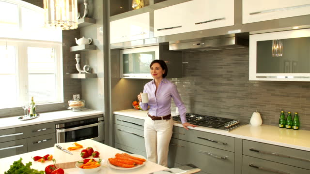young woman in the kitchen - luxury stock videos & royalty-free footage