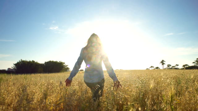 Young woman in the midle of a cereal field