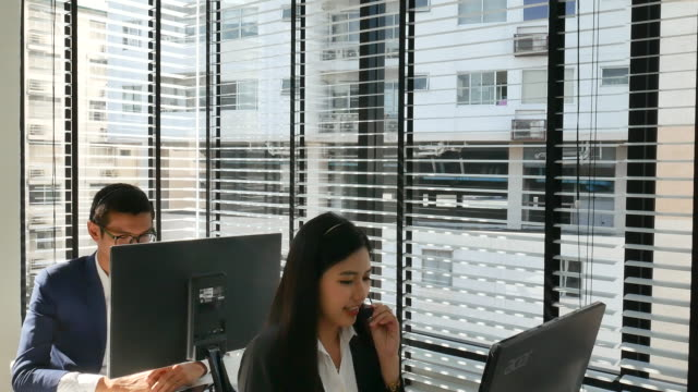 young woman in the office with headset