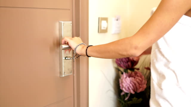 young woman in towel open the door - bracelet stock videos and b-roll footage