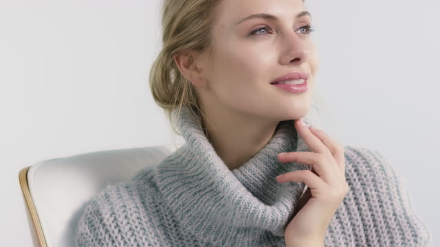 young woman in turtleneck sweater sitting on chair - jumper stock videos and b-roll footage