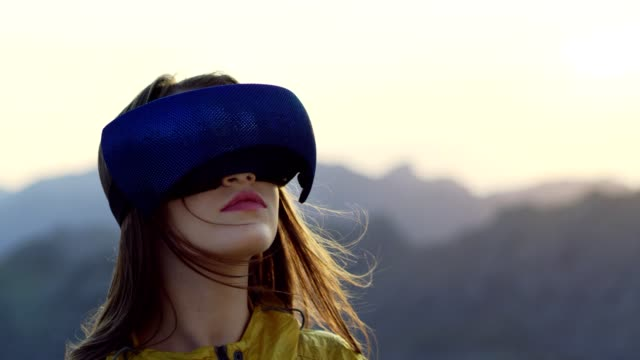 young woman in virtual reality glasses enjoys the view - wearable computer stock videos & royalty-free footage