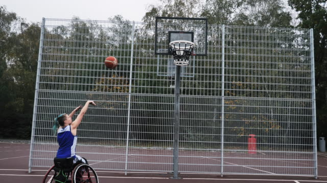 young woman in wheelchair playing basketball - disability sport and recreation - cerebral palsy stock videos & royalty-free footage