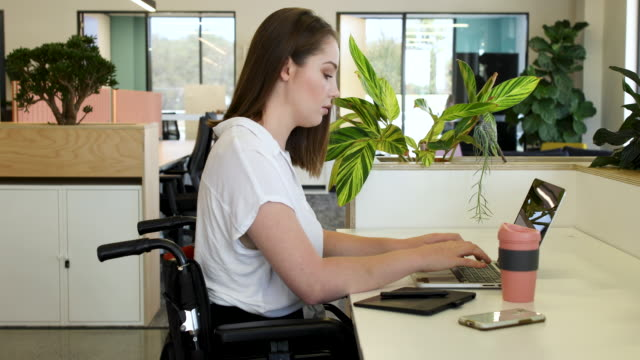 young woman in wheelchair working - medical equipment stock videos & royalty-free footage