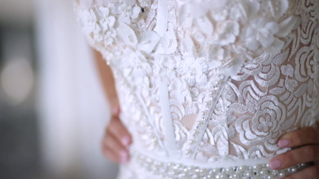 young woman in white elegant and luxury long dress - abito da sposa video stock e b–roll